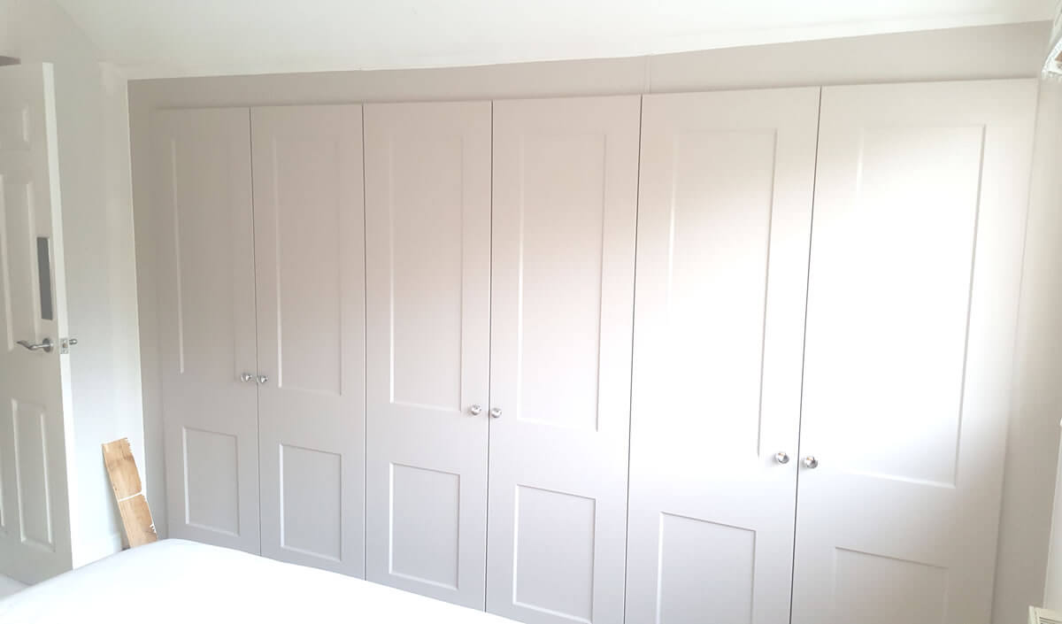 Fully bespoke 3x double wardrobes in Matt Cashmere and Cambridge Style doors.