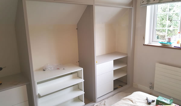3 levels pull out double depth shoe trays and short hanging rail above with long hanging rail to the right / 3 x drawers with 3 x shelves to the right and short hanging rail above.