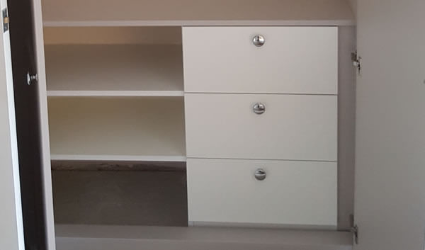 3 x drawers with 3 x shelves to the right and short hanging rail above.