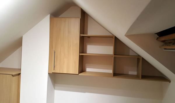 Bespoke short wardrobe, wall cupboard & shelves above bed